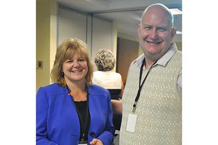 Jason Pendergast, CEO Scholarship recipient from the Class of 2013, with the New Hampshire Bankers Assocation's Sandra Tracy.