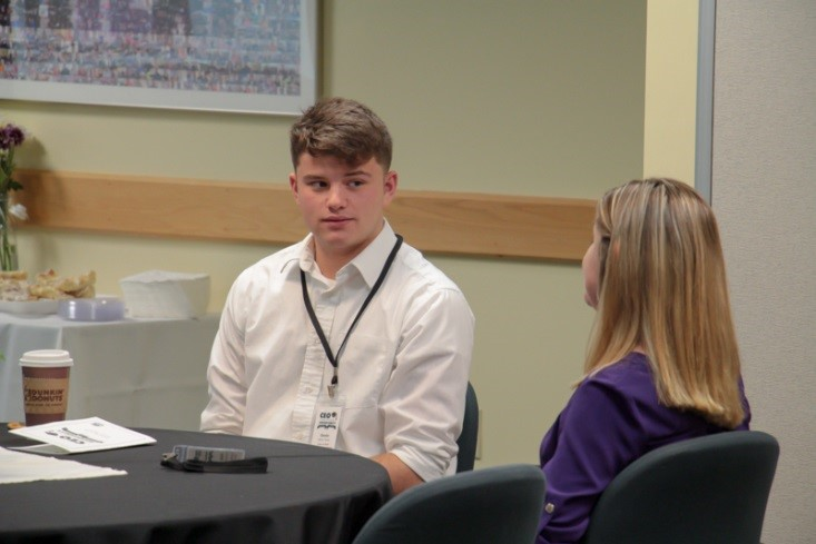 CEO Scholarship Class of 2018 recipient Devin Taves speaks with his mentor, Kearsarge Regional High School's Dr. Amanda Downing.