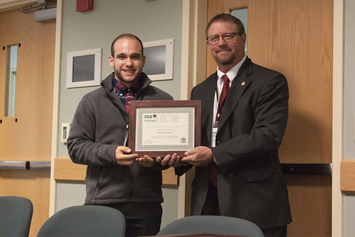 Jonathan Gonsalves (Nashua, NH) from the University of New Hampshire-Manchester receives his scholarship from NHHEAF Network Organizations' President & CEO René A. Drouin.